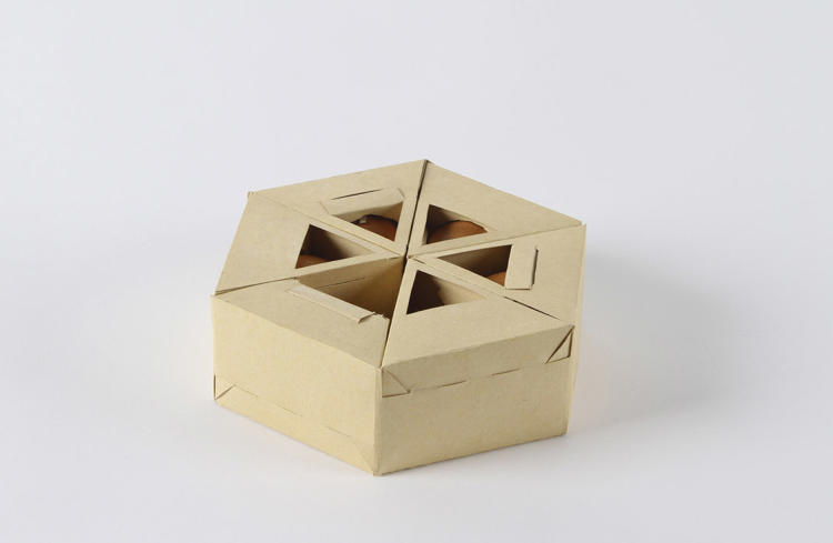<p>The design holds six eggs, which fold into a cardboard Hex-Egg-On.</p>