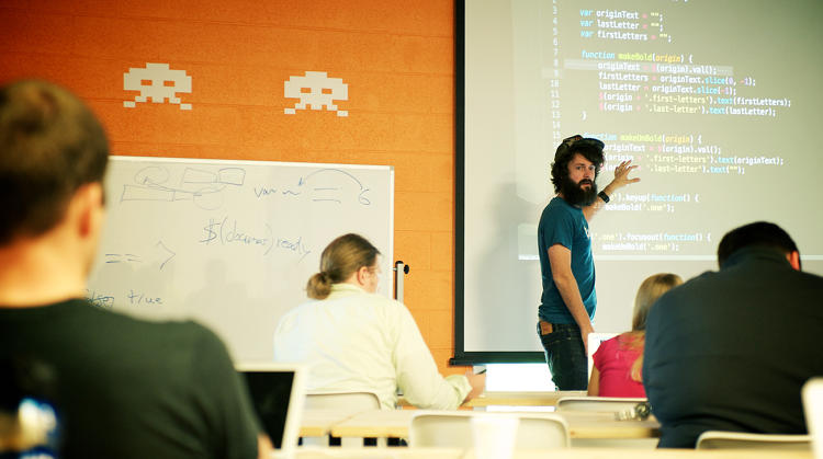 <p>Mason Stewart, CTO and lead instructor, conducts code reviews of student homework for the whole class.</p>