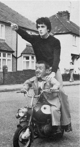<p>Kenny Baker gives Anthony Daniels a lift around town.</p>