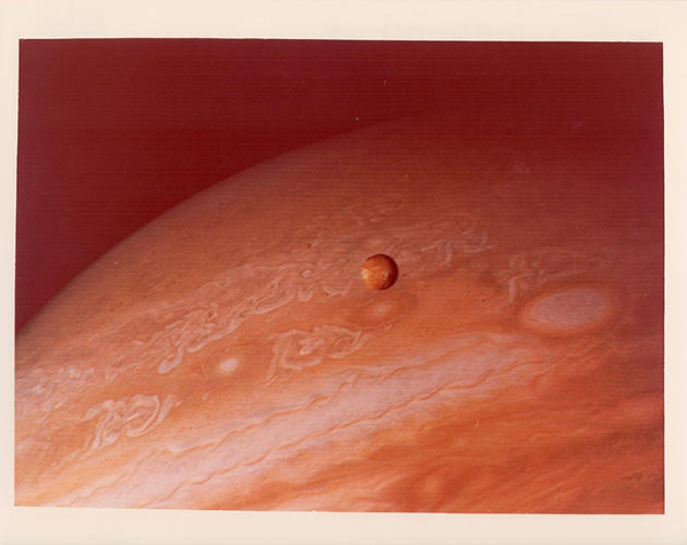 <p>Jupiter and its moon Io seen from Voyager 2, June 1979</p>