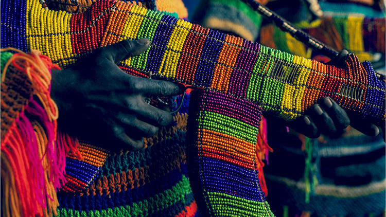 <p>While living in Johannesburg last year, artist Ralph Ziman commissioned a group of street vendors, most of them refugees from Zimbabwe, to create AK-47s using traditional beading techniques.</p>