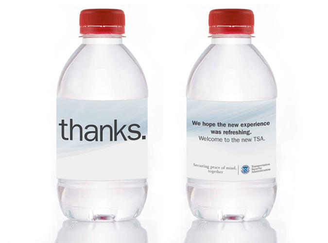 <p>Water bottles handed out to travelers after they've made it security would replace trashed liquids.</p>