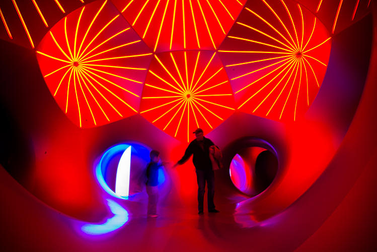 <p>The luminarium attracts visitors of all ages: Some relax on the ground while kids run from room to room.</p>