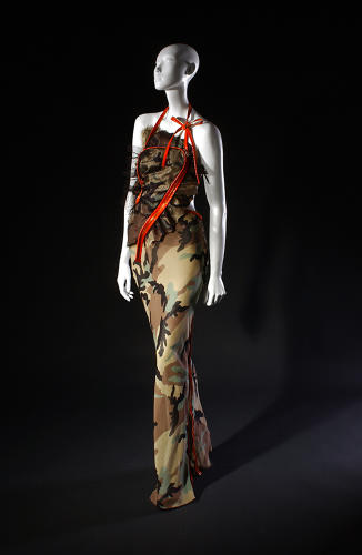 <p>Camouflage has made a comeback of late on both the runway and on fast fashion racks. Christian Dior (John Galliano), evening dress, camouflage print silk, spring 2001.</p>