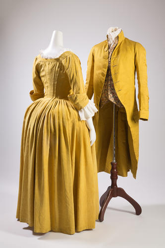 <p>The Bustle: before silicon injections, if you wanted a freakishly exaggerated posterior, you turned to the unwieldy contraptions worn under your skirt. Left: Dress, yellow silk faille, circa 1770. Right: Men's coat, yellow silk, circa 1790.</p>