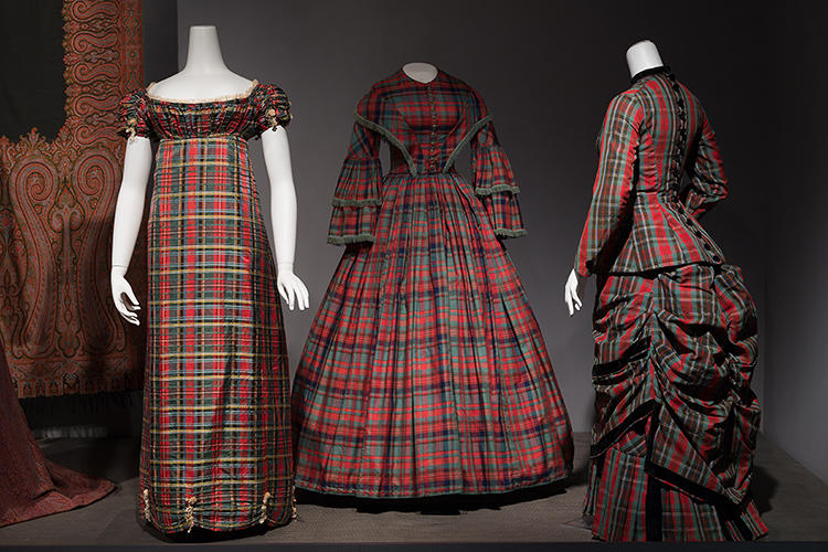 <p>Like camouflage, tartan and plaid prints have gone in and out of style for decades. (From left) Dress, red, yellow, and green tartan silk, circa 1812; day dress, red, navy, and green tartan silk blend, circa 1852; two-piece dress, red, green, and blue tartan wool and black velvet, circa 1880.</p>