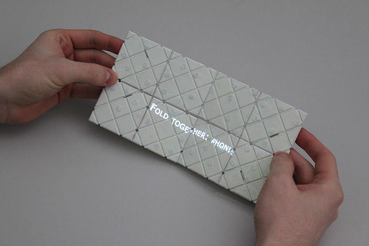 <p>It's a folding plate puzzle consisting of a loop of eight square shaped tiles that can be transformed in a variety of surprising ways.</p>