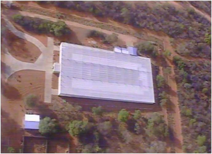<p>The Falcon UAV unpiloted aircraft offers a bird's-eye view of a rhino and elephant quarantine facility during the day.</p>