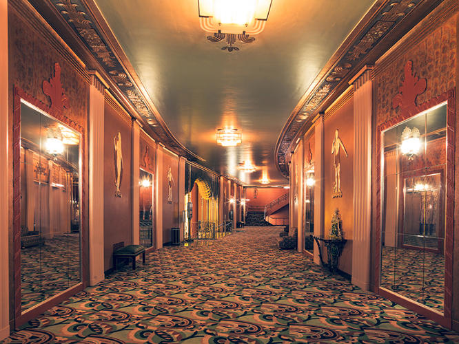 <p>But the emptiness is also a bit eerie, as if the spaces house ghosts of the thousands of viewers that once sat rapt in their seats. Paramount, Corridor, Carlifornia, 2014</p>