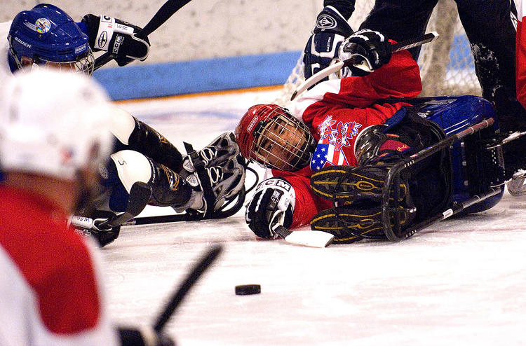 <p>Sled hockey may be done from a sitting position, but that doesn't make the hits any less brutal.</p>