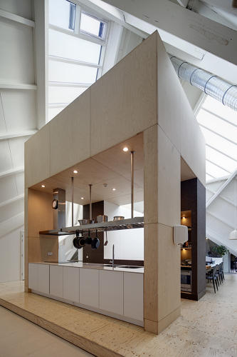 <p>To bring light to the dark interior, the architects added a rectangular shaft that goes through the whole building from the roof to the bottom floor.</p>