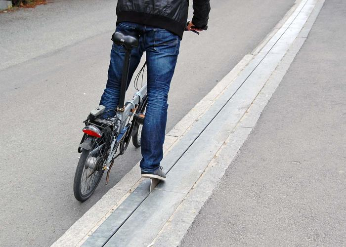 <p>Set on a particularly steep hill in Trondheim, Norway, the Trampe is a motorized aid for cyclists.</p>