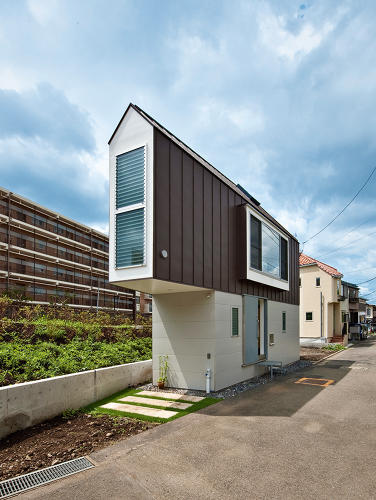 <p>This tiny house was built for a couple and their daughter in an awkward triangular lot between a river and a road. Inside, a sloping loft area packs two rooms into one. Mizuishi uses creative angles and light to build a house that's like a clown car: it seems to fit an impossible amount of furniture and comfort into what's technically a small space.</p>