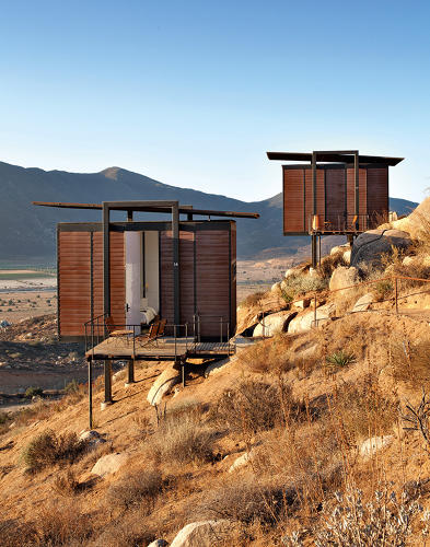 "<p>Each of the 20 rooms in this ""design hotel,"" as the architects call it, is a 60-square-foot hut on stilts, located in the mountains of wine-producing region Baja, California.</p>"