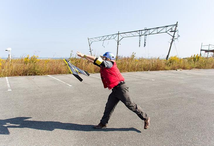 <p>From an abandoned school baseball field, the team launched a drone to help map two towns roughly equidistant from the reactor.</p>