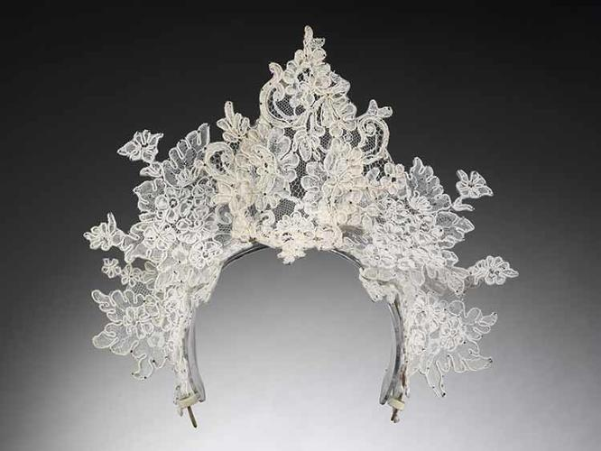 <p>Tradition dies hard, and today's bridal shops are, for the most part, still filled with a blizzard of chaste Victorian white. An antique lace tiara created by Philip Treacy, London, 2008, designed for Nina Farnell-Watson for her wedding to Edward Tryon.</p>
