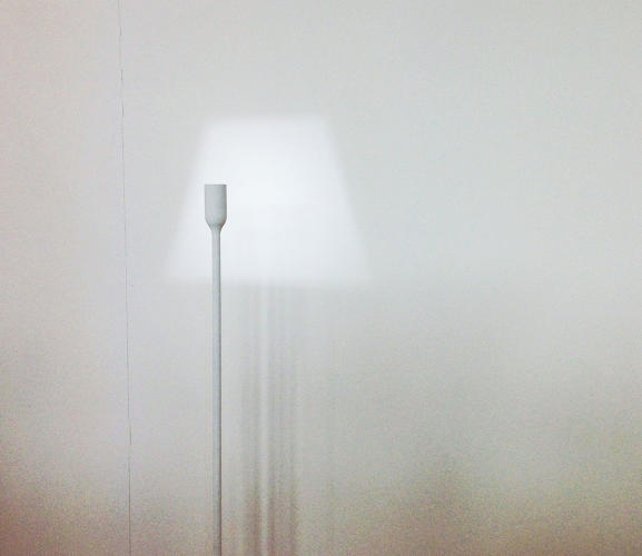 <p>Japanese design studio Yoy's hyper-minimal light simply casts a lampshade-shaped beam onto the wall.</p>