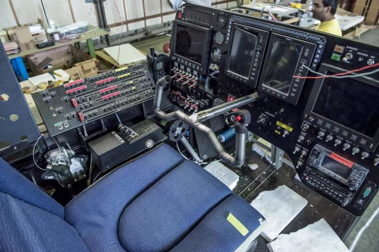<p>Inside the cockpit, there's just enough room for the pilot, a bathroom, and a little space to lie down or get some exercise.</p>