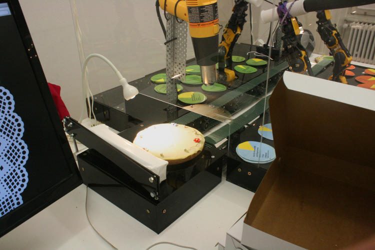 <p>So, in order to demonstrate the absurdity of the imbalance, she built a robot that used a vacuum cleaner to suck up workplace gender ratio pie charts and affix them to melting chocolate on pies.</p>
