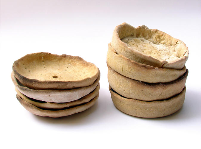 <p>Greek designer Kostantia Manthou came up with the approach: A simple kit for making a bread-based box that can later break off into portions that double as miniature plates.</p>