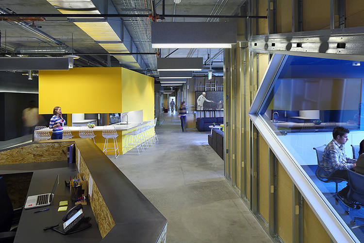 "<p>Wilkinson placed the kitchen--painted a shocking yellow--along with café tables in the middle of the space, and put couches nearby. ""Is it a bit messy, yes,"" he admits, of the unorthodox arrangement. ""But deliberately."" Because the kitchen is central, it's the place where the entire team of producers, accountants, and lawyers crosses paths. And it's a gathering spot to live-blog <em>Game of Thrones</em>.</p>"