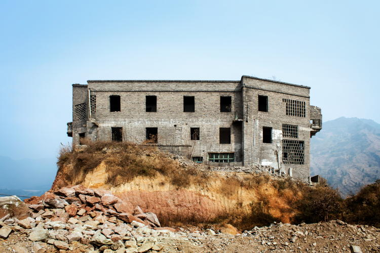 <p>Though Yunyang is mostly destroyed, some residents stayed behind. There is still a coal briquette factory in the area.</p>