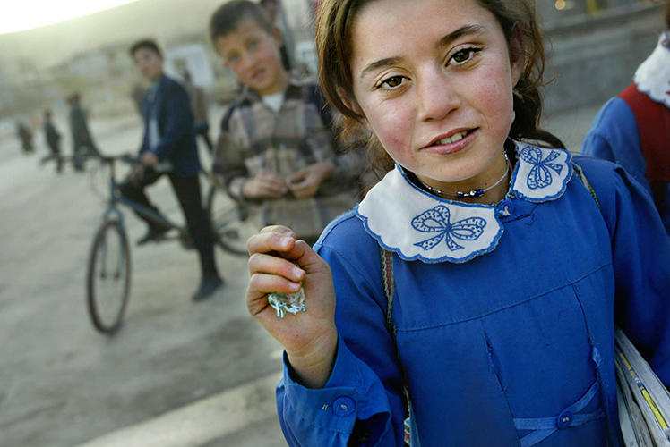 <p>Getty is making a curated selection of its images available to anyone through <a href=&quot;http://www.photos.com&quot; target=&quot;_blank&quot;>Photos.com by Getty Images</a>, where you can purchase high-quality framed prints of the agency's best photography. Here, A Kurdish schoolgirl walks home from school March 3, 2003 in Cizre, Turkey. Tensions were high in the Kurdish town of Cizre, about 15 miles from the Iraqi border.</p>