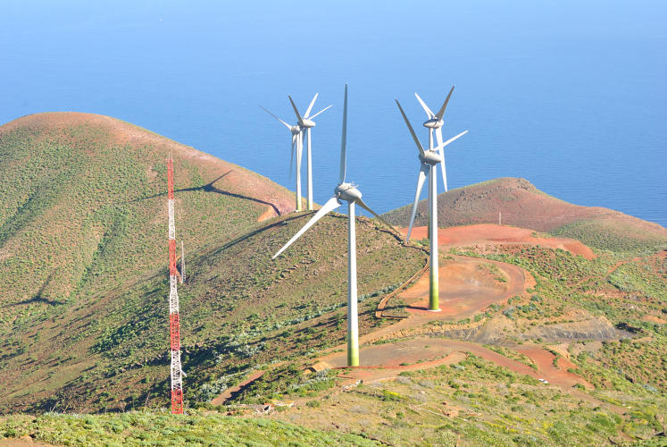 <p>Wind turbines sit on hills in northern El Hierro, powering the pumps that draw water from the sea.</p>