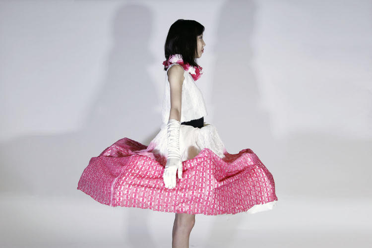 <p>The dress came out of the artist's experiences living in Hong Kong, where she's currently finishing her MFA.</p>