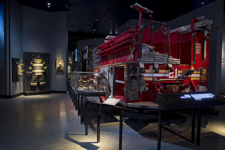 <p>FDNY ENGINE COMPANY 21 TRUCK<br /> Dispatched to the WTC after the South Tower was struck. The vehicle's front was damaged by debris.</p>