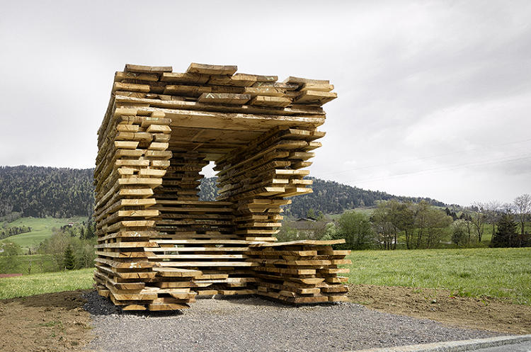 <p>Ensamble Studio, from Spain, designed a bus stop of layered, untreated oak planks.</p>