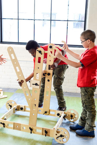 "<p>As kids improvise with building elaborate ""Rigamajigs&quot; from planks, wheels, pulleys, nuts, bolts, and rope, they learn about engineering, architecture, creativity, and collaboration.</p>"