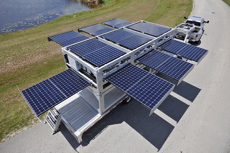 <p>Hidden solar panels slide out of drawers on each side and start immediately start generating energy wherever they're needed, whether for disaster relief or in a remote village far off the grid.</p>