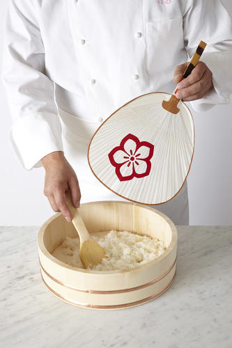 <p>Sushi chefs use their hands much like sculptors or potters do. A fan is used to cool down freshly steamed sushi rice.</p>