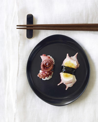 <p>The book offers 75 recipes. Here, Nigiri with octopus (tako). These chefs design plates that are as entrancingly beautiful as they are delicious.</p>