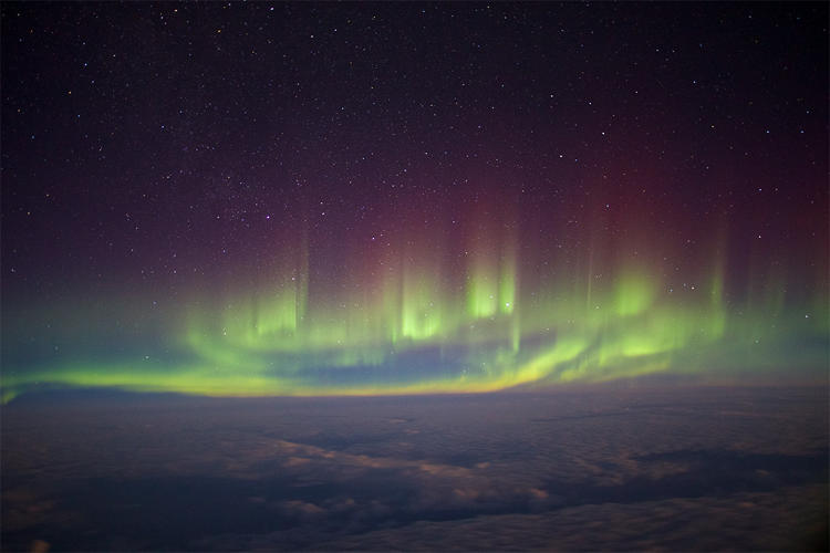 <p>Aurora seen from the window of a transatlantic flight between London and New York in February 2014. The photographer balanced his camera on his backpack to capture the greatest natural light show on earth from a rare perspective.</p>
