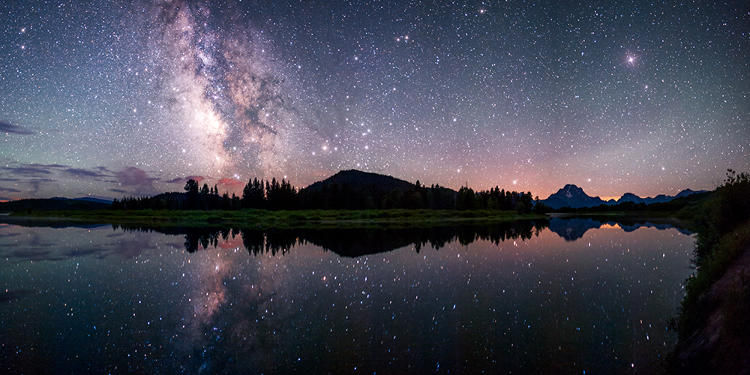 <p>The Milky Way reflected in the Snake River at the famous Oxbow Bend in Grand Teton National Park.</p>