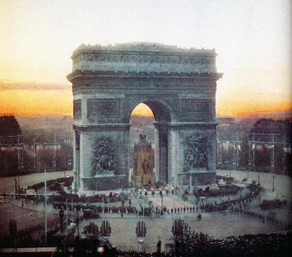 "<p>Victory celebration at Arc de Triomphe, Paris, 14 July 1919. ""It surprises readers, because our visual memories have been trained to think of the early 20th century as a black-and-white era.""</p>"