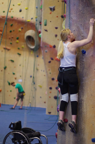 <p>Paraplegic climber ascends wall at Brooklyn Boulders.</p>