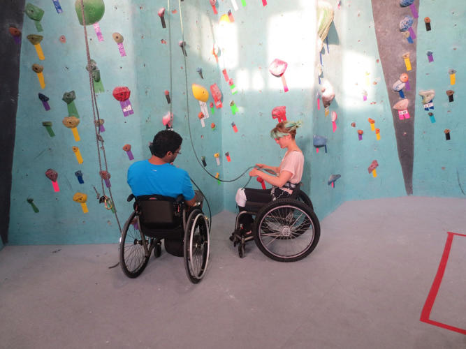 <p>Quemuel Arroyo and Chloe Crawford tie in before a climb at Brooklyn Boulders</p>