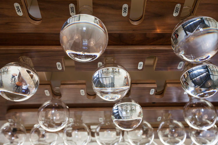 <p>Once they're done looking around, most visitors to the Interval will wind up sitting at the bar, which serves coffee and alcohol. Bottles hanging in the rafters contain special &quot;Long Now Gin,&quot; reserved for members who donated at least $1,500 to the Interval's crowdfunding campaign.</p>