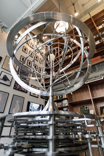 <p>The Orrery, a display that features all the planets visible from Earth, was in the back of the old Long Now museum space, but now it's moved front and center. It's now one of the first things you see upon walking into the space.</p>
