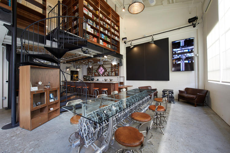 <p>The Long Now Foundation has transformed its formerly nondescript space into a combination bar, coffee shop, museum, presentation space, and office, complete with Brian Eno artwork and a giant chalkboard that will soon be used by a chalkboard-writing robot.</p>