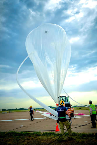 <p>The World View team fills the high-altitude balloon with lift gas prior to launch.</p>