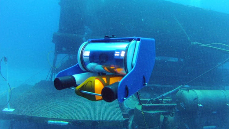 <p>Designed by Eric Stackpole and developed with David Lang, OpenROV is an open-source research and development project for the public to explore the seas (or caverns, lakes, and almost anywhere underwater where the ROV's tether will reach). Applications range from scouting dive locations to search and rescue, as well as education.</p>