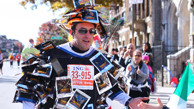 <p>Levin running the NYC Marathon in 2011, while dressed as the Jerk Man.</p>