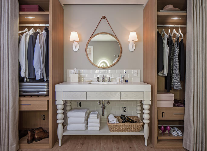 "<p><strong>The bathroom and closet space are geared toward a growing segment of female business travelers.</strong><br /> <strong>11.</strong> Pull-out shoe racks give the vibe of the perfectly organized closet.<br /> <strong>12.</strong> A real deal hair dryer described to be ""of a decent wattage.&quot;<br /> <strong>13.</strong> This space fits a medium- to large-sized shopping bag.<br /> <strong>14.</strong> Plenty of towels--but you can order more through your TV/smartphone app if you'd like.</p>"