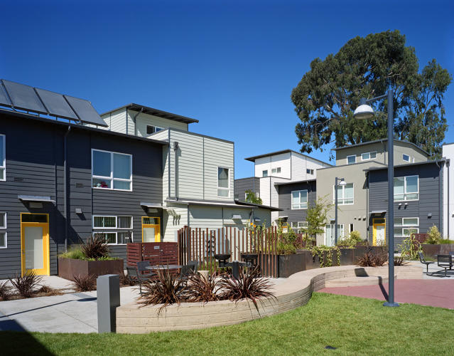 <p>The development reused the old factory building to reduce waste. Though the apartments and townhouses are designed for average incomes of only $15,000, the neighborhood doesn't look like public housing.</p>
