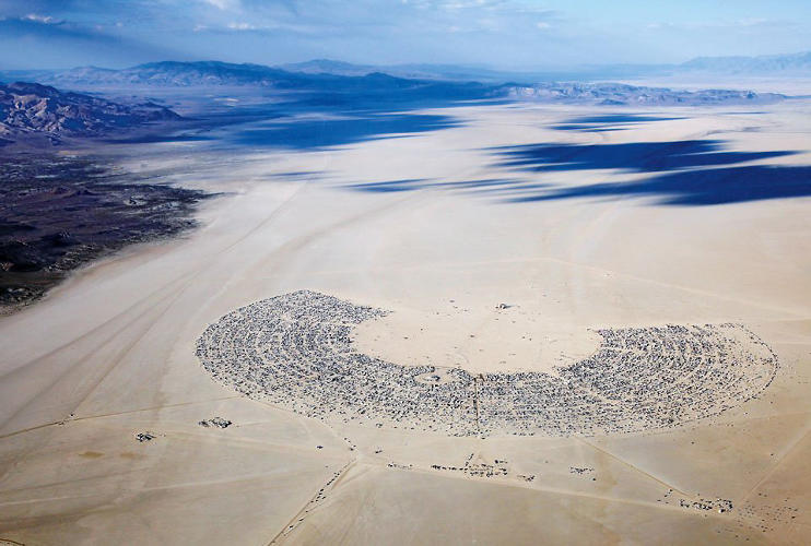 <p>City plan by Rod Garrett<br /> An aerial view of Black Rock City, the temporary city in the Nevada desert that is home to Burning Man.</p>