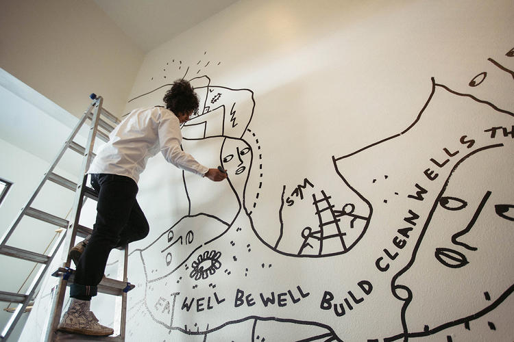 <p>Martin draws on everything: walls, sneakers, and people.</p>